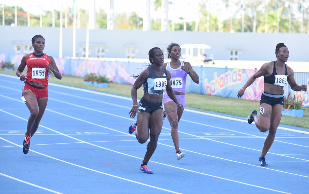 Samantha Henry-Robinson (centre) wins the women's 100m at the Blue Marlin Track and Field Classic at the Thomas A Robinson Stadium on July 10, 2016