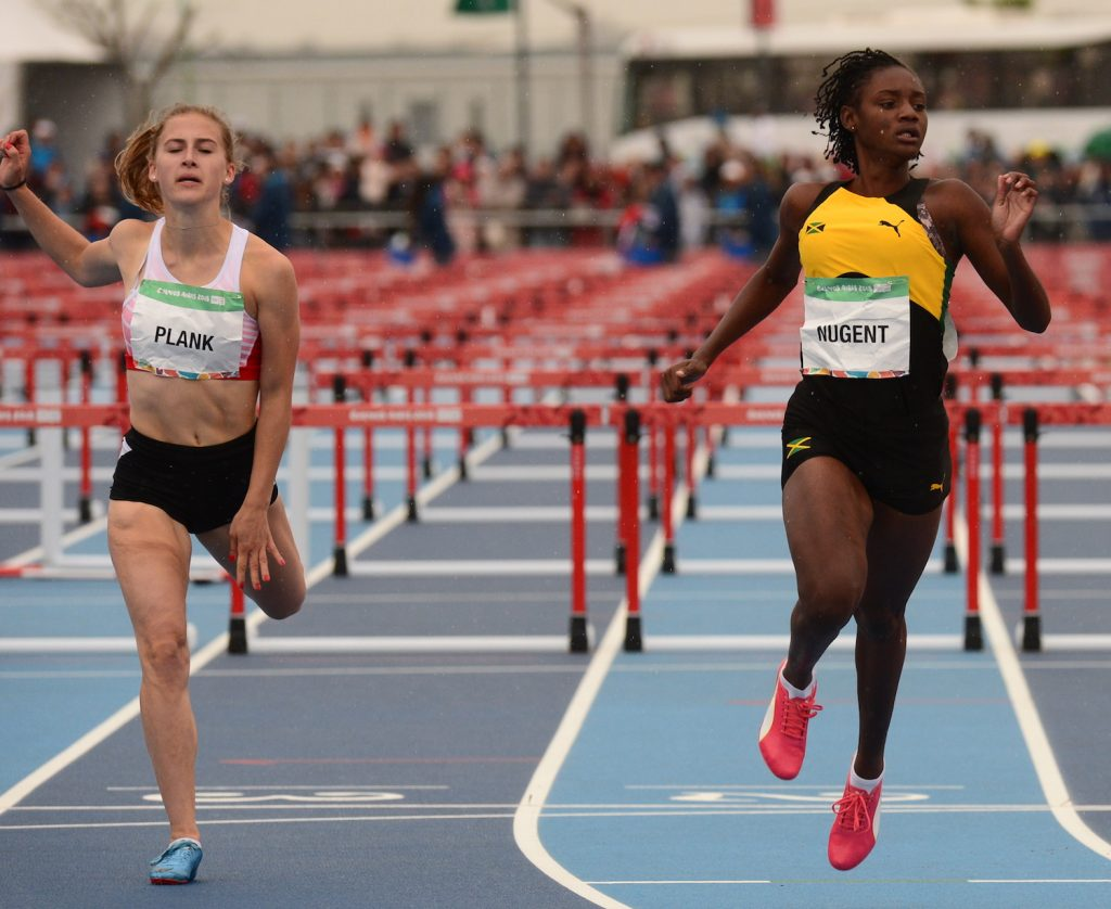 Ackera Nugent wins her heat of the 100m hurdles for girls in 13.46 ahead of Johanna Plank at the Youth Olympics Games in Argentina on Thursday, October 11, 2018. She holds the third fastest time of the three heats.