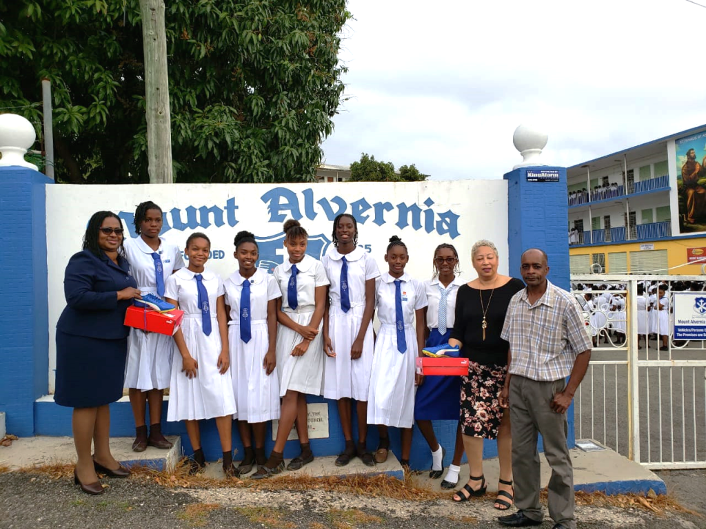Pictured from L- R: Sharon Palmer (Branch Supervisor, BCIC Montego Bay Branch , Members of the Mount Alvernia High School Track & Field Team, Gabrielle Lee (Senior Account Executive, Allied Insurance Brokers Ltd.) and Andrew Henry (Coach of the Mount Alvernia High School Track & Field Team)