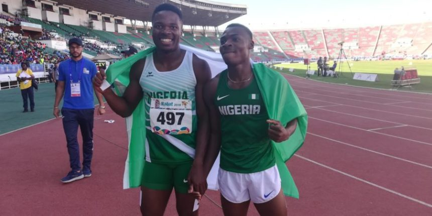 Raymond Ekevwo, right, and Gue Arthur Cisse first and second at All African Games