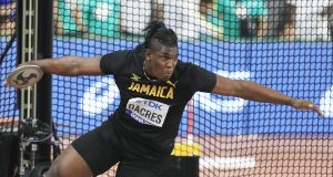 Dacres wins historic silver medal in men's discus
