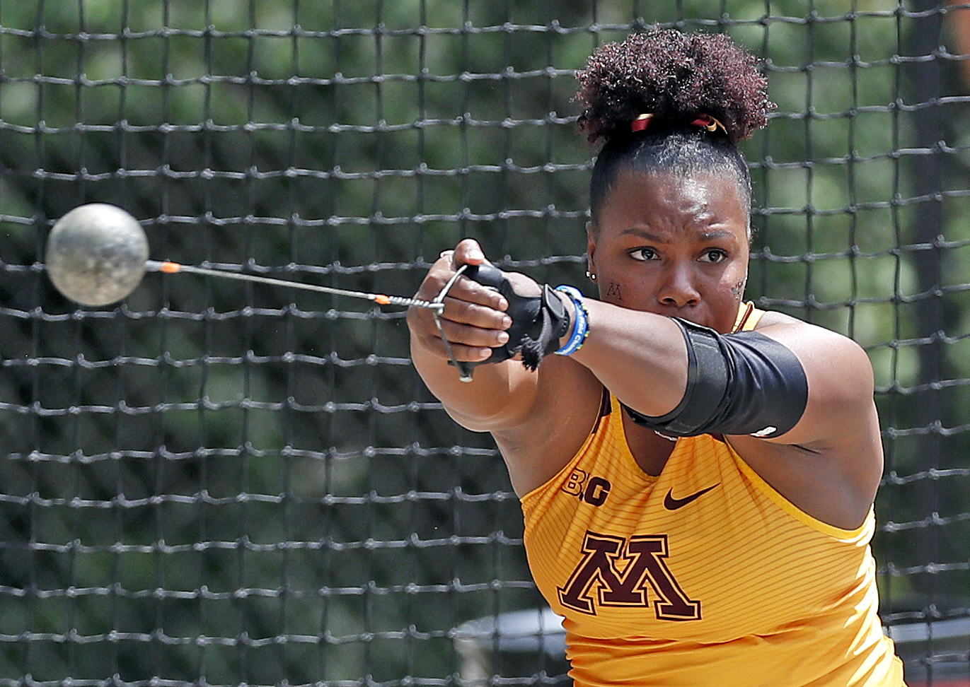 Nayoka Clunis' 20.98m throw gave her third in the women's weight throw event